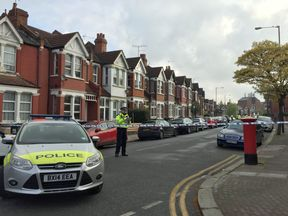 Police at the scene in Harlesden Road, Willesden