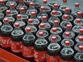 Plastic bottles of Coca-Cola on a production line