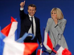 Emmanuel Macron, head of the political movement En Marche !, or Onwards !, and candidate for the 2017 French presidential election, arrives on stage with his wife Brigitte Trogneux to deliver a speech at the Parc des Expositions hall in Paris after early results in the first round of 2017 French presidential election, France, April 23, 2017