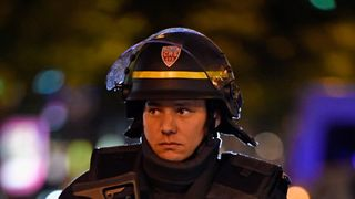 An armed police officer on the Champs-Elysees