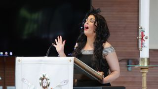 Professional dancer, TV presenter and talent show judge Róisín Mullins singing at the service