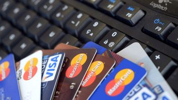 Credit cards are pictured on a computer's keyboard