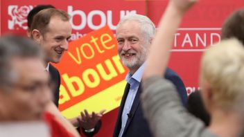 Jeremy Corbyn smiles after delivering a stump speech in Swindon