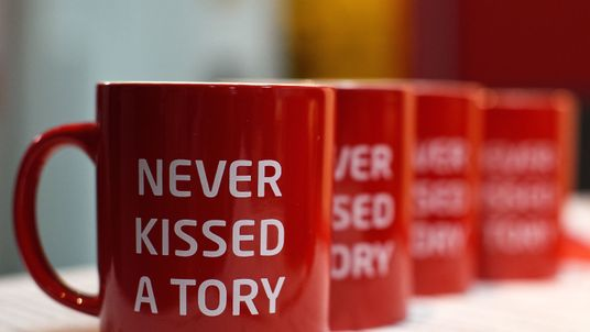 Mugs with the slogan 'Never Kissed a Tory' on display at the LGBT stand during the second day of the Labour Party Autumn Conference on September 28, 2015 in Brighton