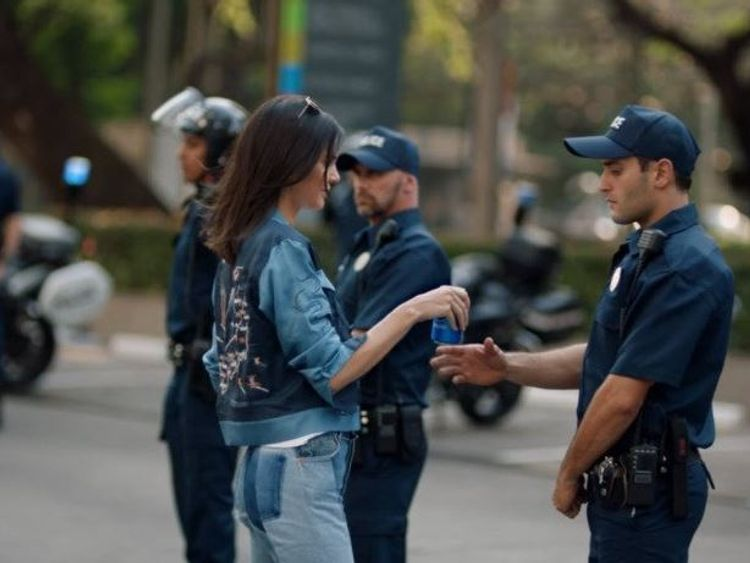 Kendall Jenner hands a police officer a Pepsi. Pic: Pepsi advert