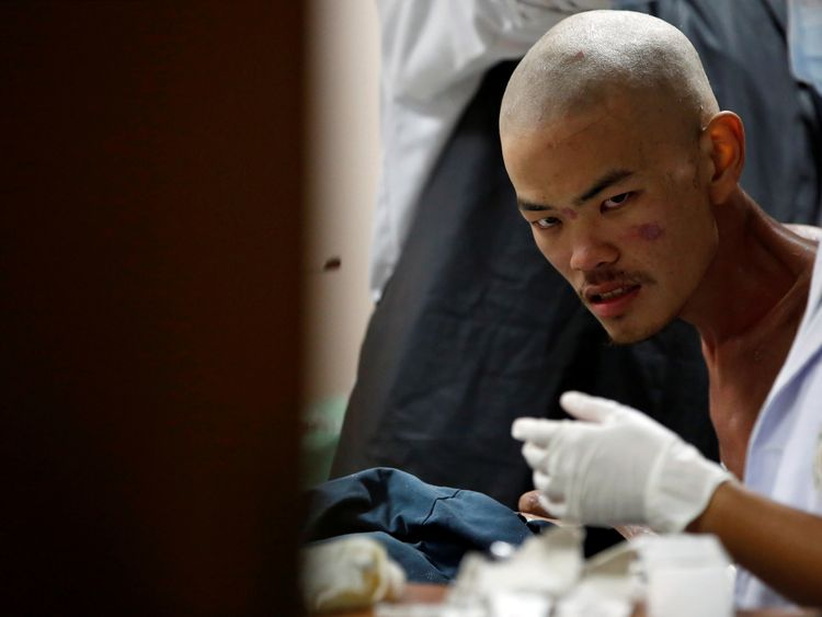 Mr Liang in hospital after he was rescued