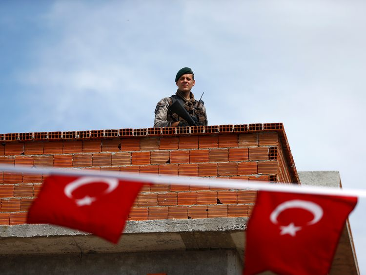 A security officer on a roof near a polling station in the Aegean port city of Izmir