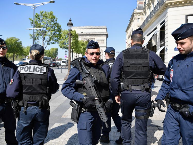 Armed police patrol the Champs Elysees