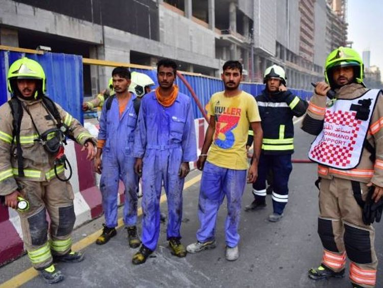 The workers who were rescued. Pic:Dubai Civil Defence/Instagram