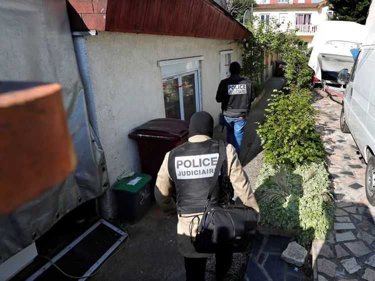 French police arrive at the house of the gunman