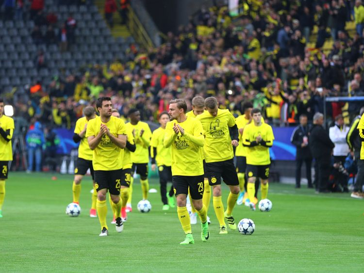 The Borussia Dortmund players take to the pitch ahead of the match against Monaco