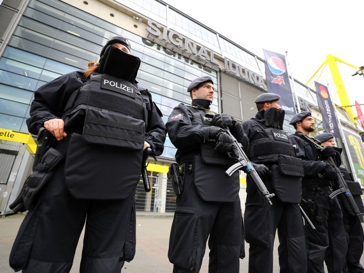 Police officers outside the stadium before the match