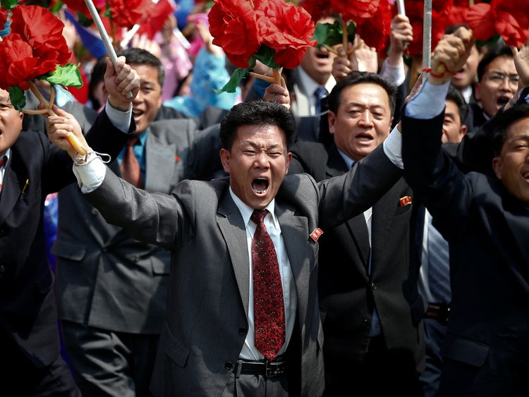 Supporters of Kim Jong Un take part in a military parade marking the 105th birth anniversary of the country's founding father