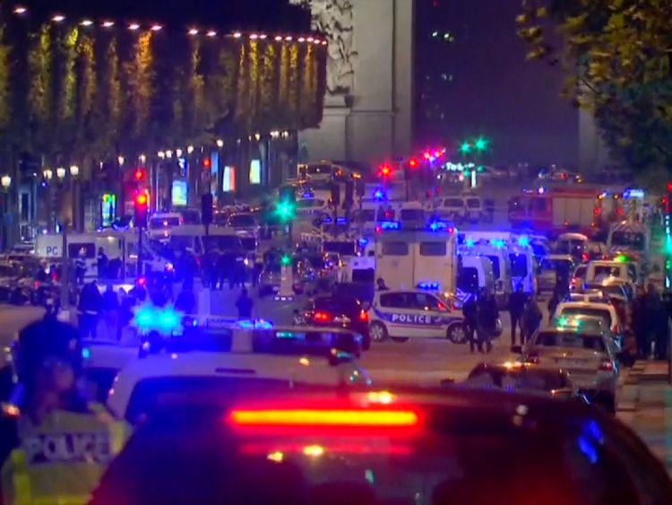 Famous Paris street comes to a standstill after a police officer is shot