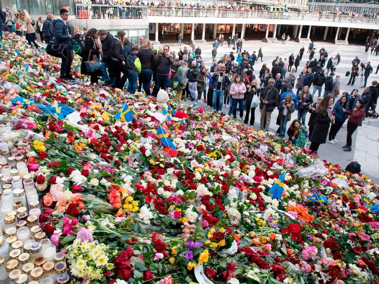Flowers left on the steps at Sergels Torg plaza in Stockholm close to the point where a truck drove into a department store