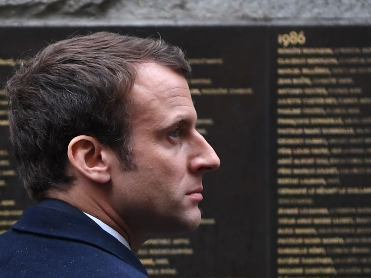Emmanuel Macron stands by the Wall of the Righteous during a visit to the Shoah Memorial in Paris