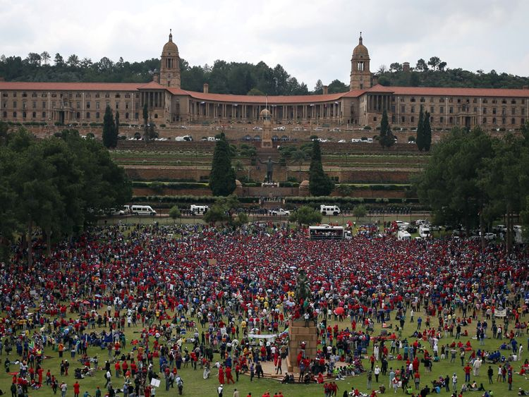 Protesters gather outside the Union Buildings in South Africa's capital to protest against President Jacob Zuma in Pretoria