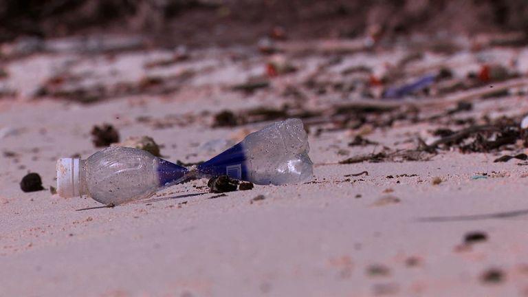 A plastic bottle litters a beach on the Cocos Keeling Islands