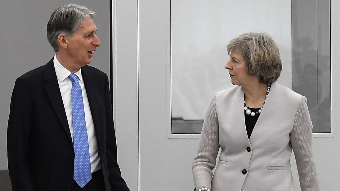 May dodges questions on Hammond's future after reports of tensions