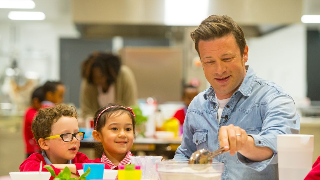 Jamie Oliver makes bread with pupils Elvis and Eleanor at Kings Cross Academy in London