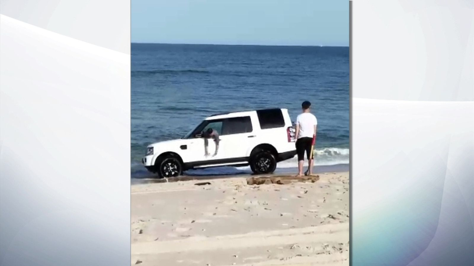 Land Rover sinks in sand 'as driver takes photos'