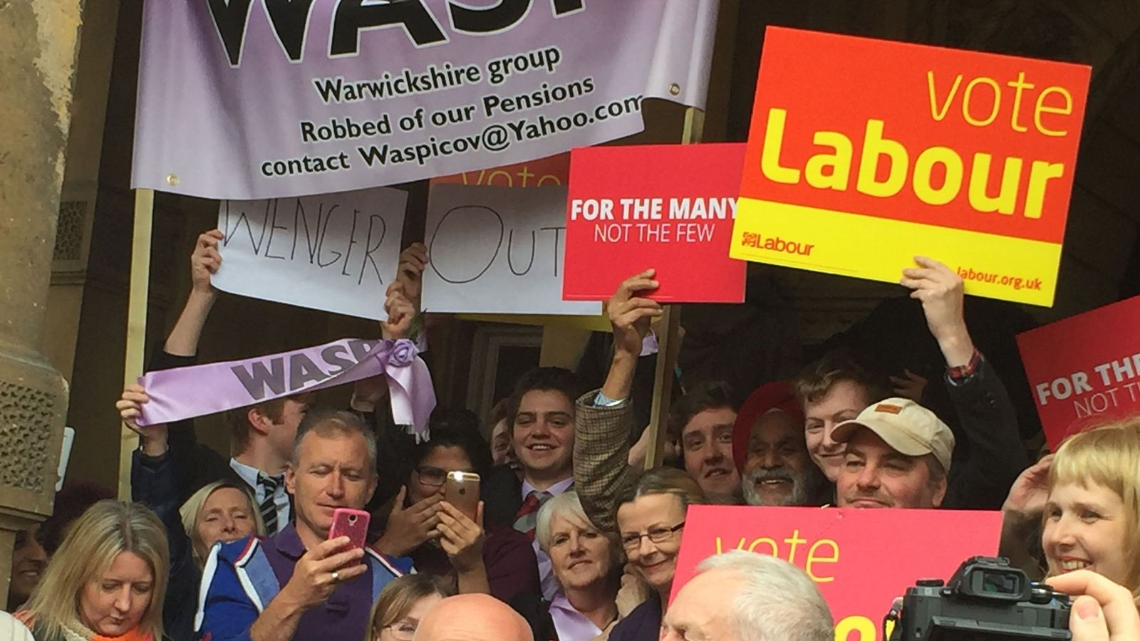 The 'Wenger Out' banner behind Jeremy Corbyn in Leamington Spa