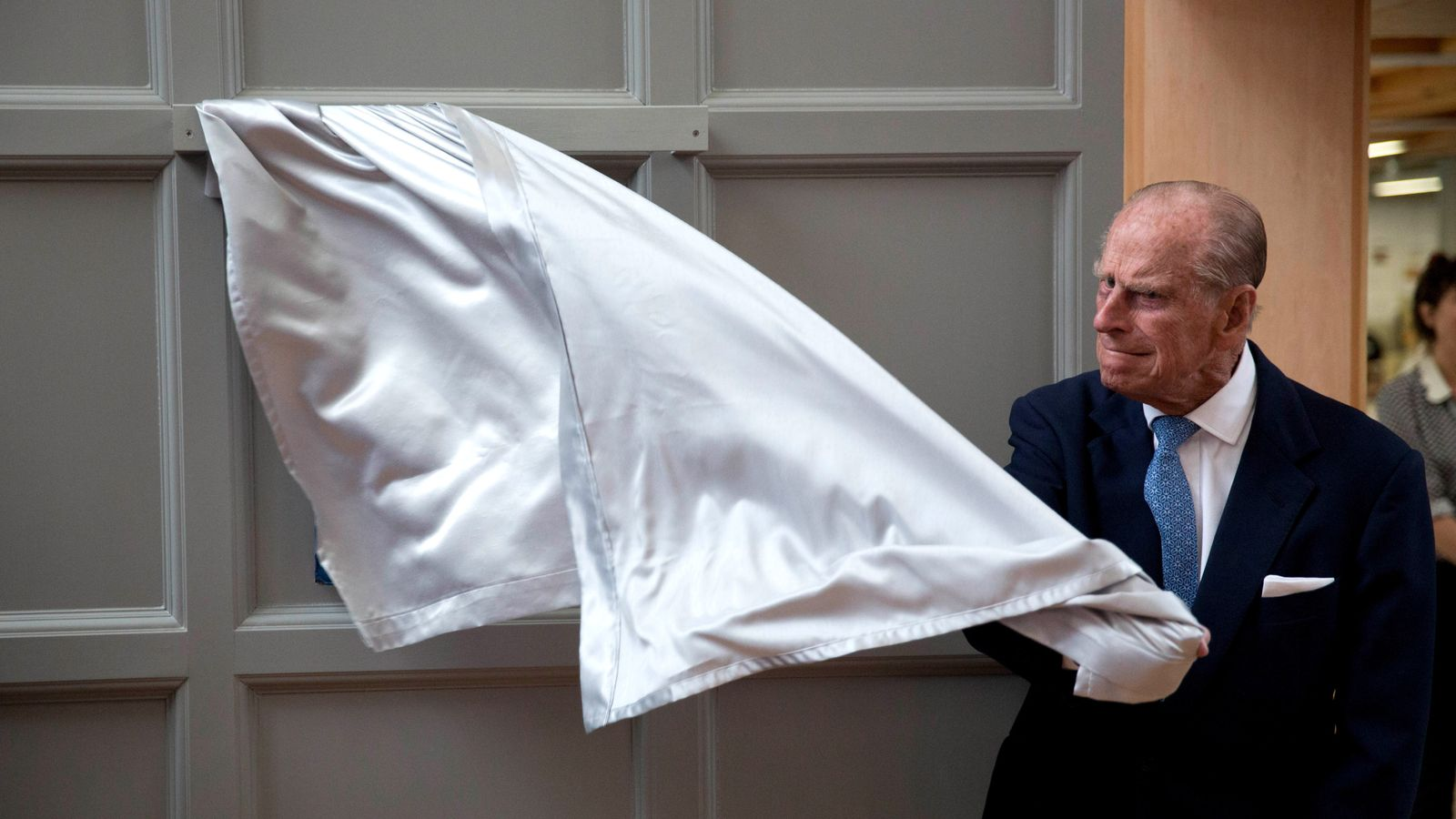Prince Philip has difficulty unveiling a plaque at one of his regular engagements.