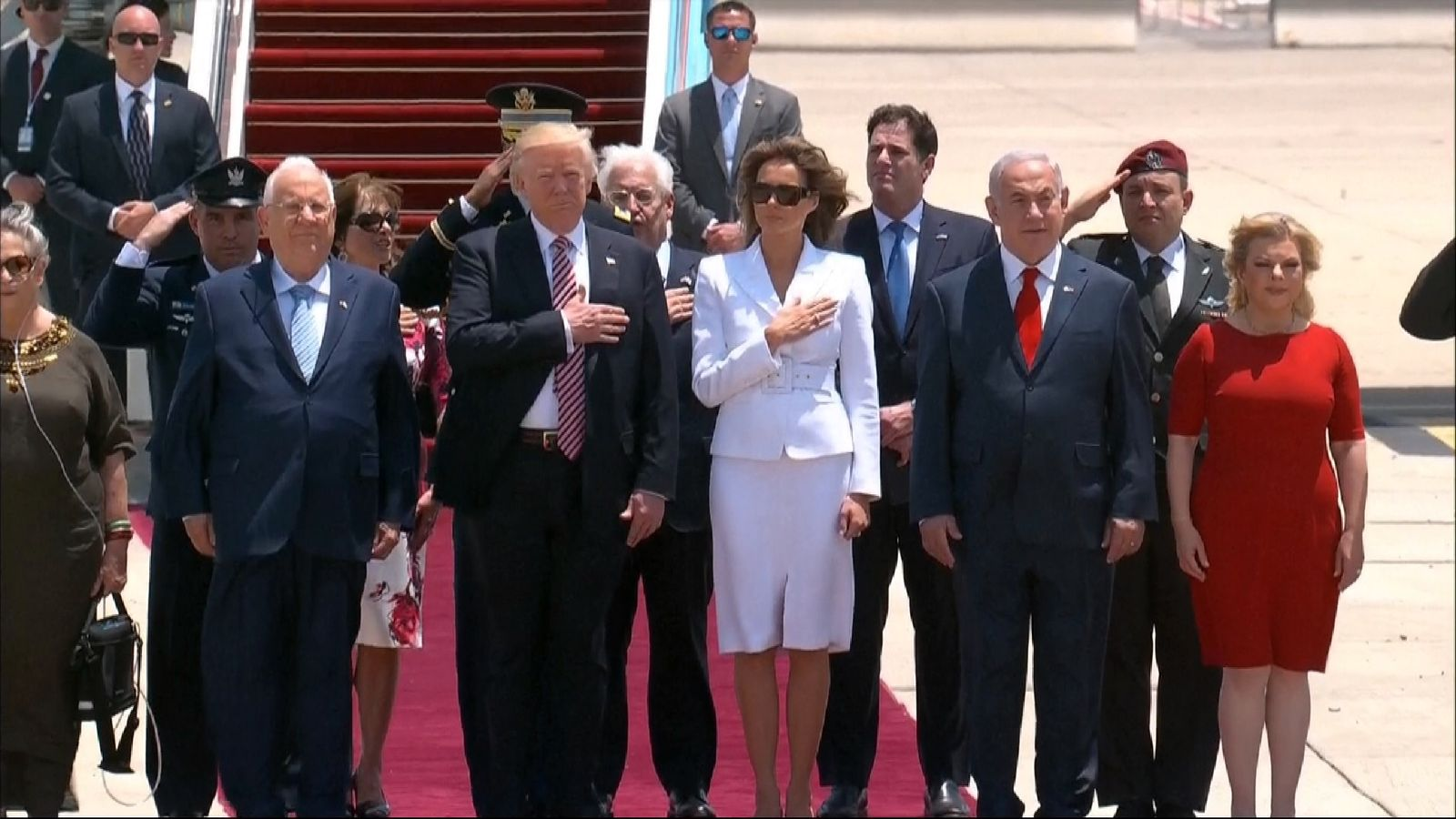 The Trumps and Netanyahus salute the US and Israeli national anthems