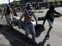 Demonstrators build barricades during a protest against Venezuela's President Nicolas Maduro's government in Tariba