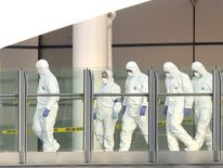 Forensic officers leave the Manchester arena