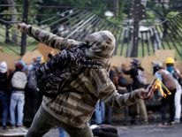 Opposition supporter clash with riot police while rallying against Venezuelan President Nicolas Maduro in Caracas