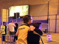 People leaving the Manchester Arena after reports of an explosion during an Ariana Grande gig