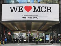 A sign saying 'We love Manchester' is displayed