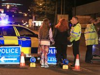 Police helping people after Manchester Arena was evacuated following reports of an explosion