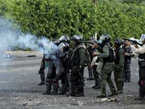Riot security forces fire tear gas canisters during a protest against Venezuela's President Nicolas Maduro's government in Tariba
