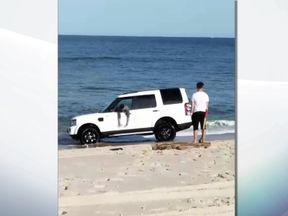 The car became stuck after the driver drove it down to the shoreline