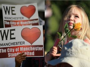 Three-year-old Ruby Tindall watches from her father Lee's shoulders during a vigil to commemorate the victims of the May 22 attack on Manchester Arena