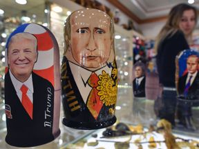 Traditional Russian wooden nesting dolls, Matryoshka dolls, depicting US President-elect Donald Trump (L) and Russian President Vladimir Putin are seen at a gift shop in central Moscow on January 16, 2017, four days ahead of Trump's inauguration