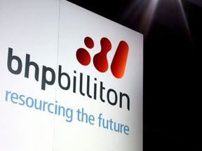 A promotional sign adorns a stage at a BHP Billiton function in Sydney