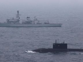 HMS Somerset escorting a Russian submarine through the English Channel. Pic: MOD