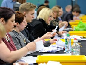 Election count staff count ballot papers at Riverside Ice & Leisure Centre in Chelmsford, Essex