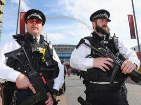 Armed officers outside Wembley Stadium before the FA Cup Final