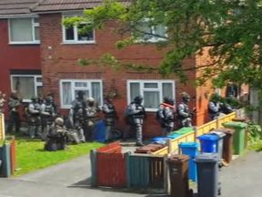 An image taken by a neighbour of the home in Fallowfield, Manchester, that was raided by police
