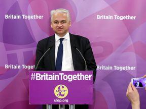 Patrick O'Flynn, UKIP's economics spokesman, speaks to reporters