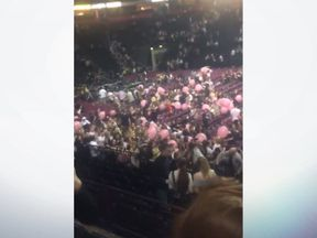 "People fleeing an ""explosion"" at Manchester Arena. Pic: @HannahWWH"