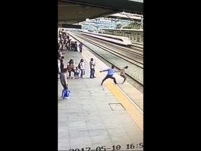 Man drags woman back from platform edge
