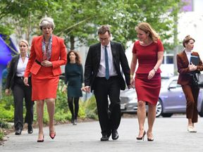Mrs May arrives at Sky News HQ, alongside Sky News head John Ryley and Channel 4 chief creative officer Jay Hunt