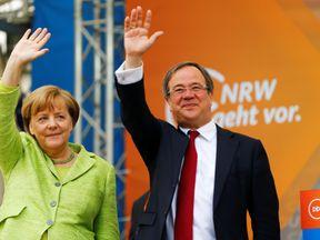 Armin Laschet is a deputy chairman of Ms Merkel's CDU party
