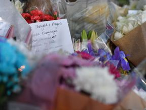 Messages and flowers are left for the victims in central Manchester