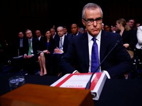 Acting FBI director Andrew McCabe arrives to testify before a US Senate Select Committee